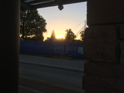 Watching the sun rise at 6 a.m. while I'm waiting for the MAX bus to come.